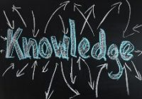 knowledge written in blue on black board