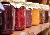 multiple jam jars with different colour produce and cloth lids