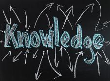 knowledge written in blue on black board