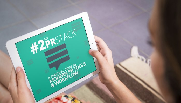 PRStack e-book on tablet being read by a woman