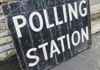 'polling station' written in white on a blackboard