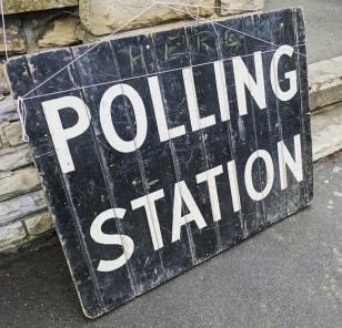 'polling station' written in white on a blackboard